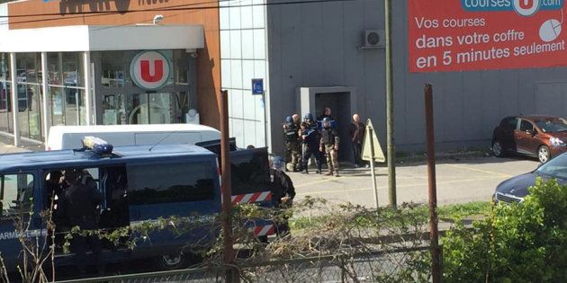 Police are seen at the scene of a hostage situation in a supermarket in Trebes, Aude, France March 23,...