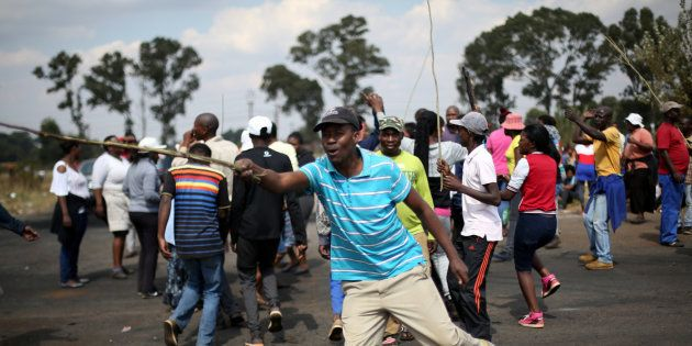 A protest over illegal land invasion in Lenasia, southwest of Johannesburg. April 25,