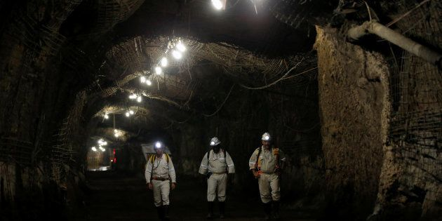 Workers are seen underground South Africa's Gold Fields South Deep mine in Westonaria, 45 kilometres...
