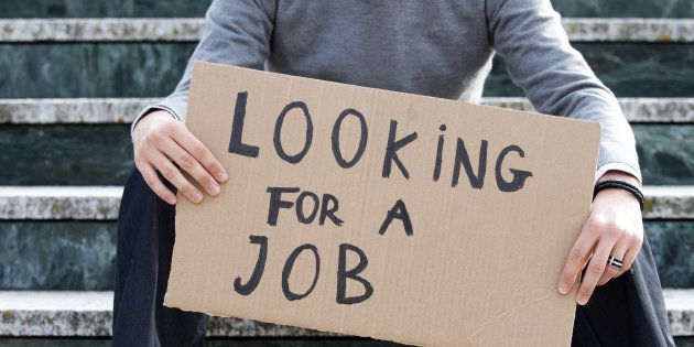 Young businessman holding sign Looking for a