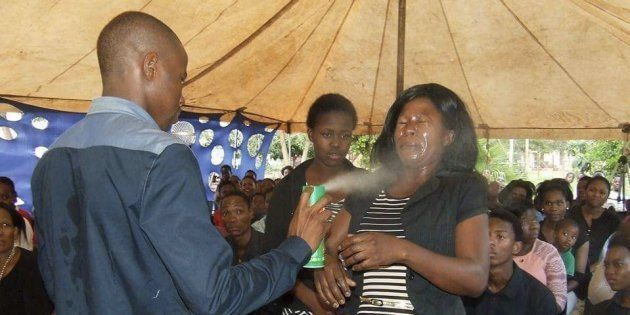 Photographs on Mount Zion General Assembly's Facebook page show Lethebo Rabalago spraying the insecticide...
