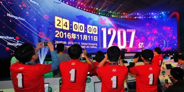 SHENZHEN, CHINA - NOVEMBER 12: Working staff of Alibaba Group take photos of a screen which indicates...