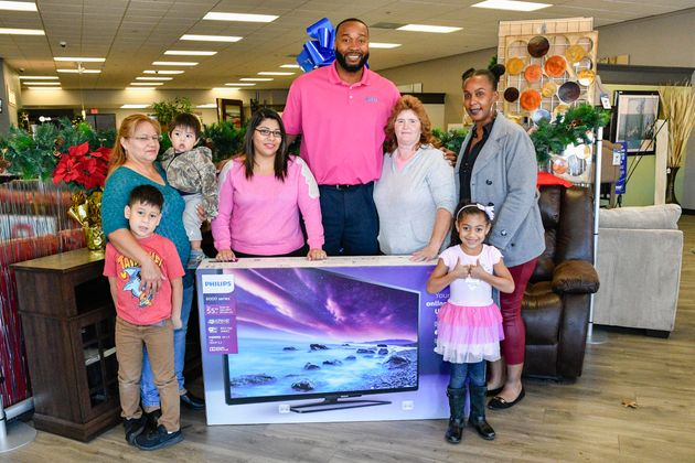 IMAGE DISTRIBUTED FOR AARON'S, INC. Aaron'€™s regional manager Tyrone Washington, center, surprised loyal...