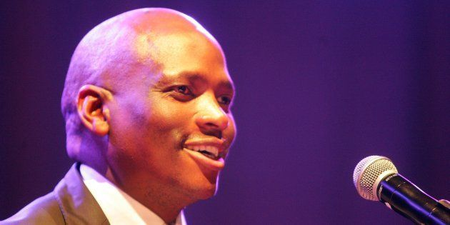 During the court case, Motsoeneng sat silently in court listening, while his supporters sang and blew...