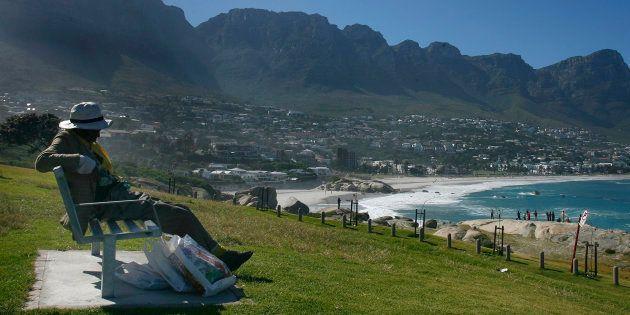 A homeless man sleeps on a bench near the beach in Cape Town December 27, 2007. A DA councillor this...