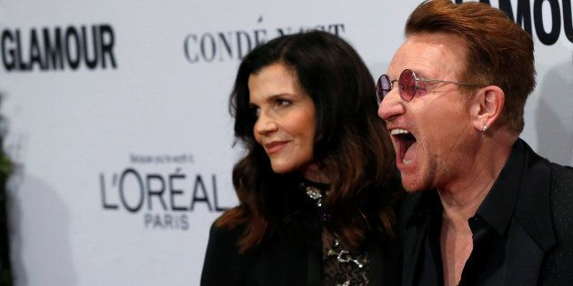 Recording artist and honoree Bono of U2 and his wife Ali Hewson pose at the Glamour Women of the Year...