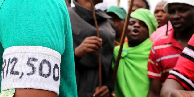 Mineworkers gather at Wonderkop stadium outside the Lonmin mine in Rustenburg, northwest of Johannesburg...