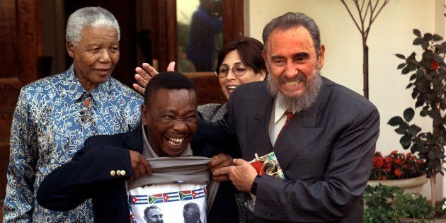 Blade Nzimande, General Secretary of the South African Communist Party, shows his shirt printed with...