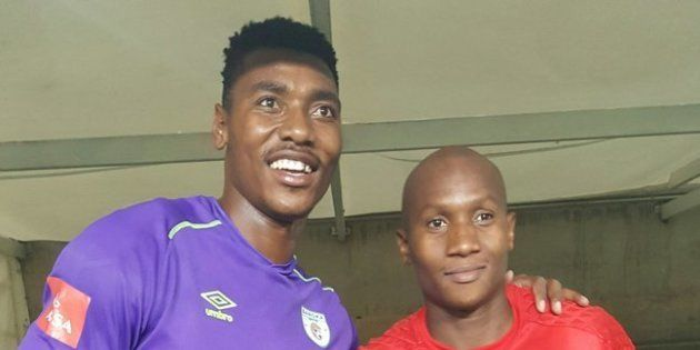 Baroka FC goalkeeper Oscarine Masuluke, with Orlando Pirates FC goalkeeper Jackson Mabokgwane after the...