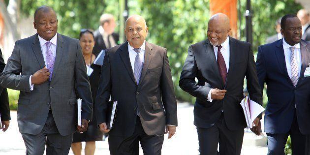 The minister and his men... Minister of Finance Pravin Gordhan (centre) has ordered an inquiry into