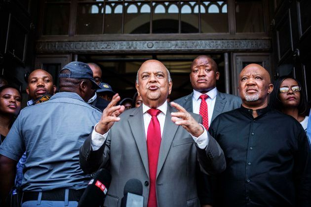 Former South African finance minister Pravin Gordhan (C) and his deputy Mcebisi Jonas were the first...