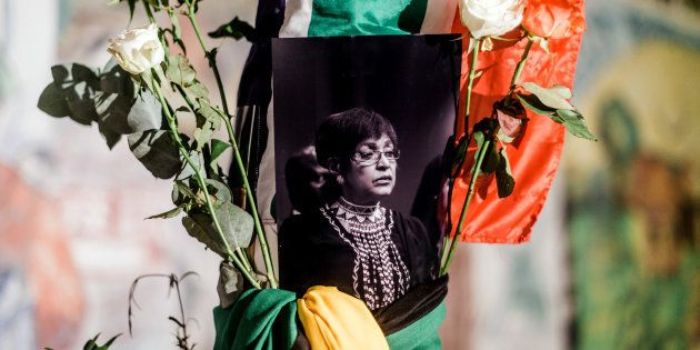 South Africans gather to pay respect to Mam' Winnie during a candle vigil in Durban on April 2,