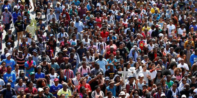 University of Cape Town (UCT) students march to the university's administration block during protests...