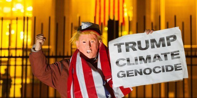 A protestor dressed as US President Elect Donald Trump takes part in a demonstration outside the US Embassy,...