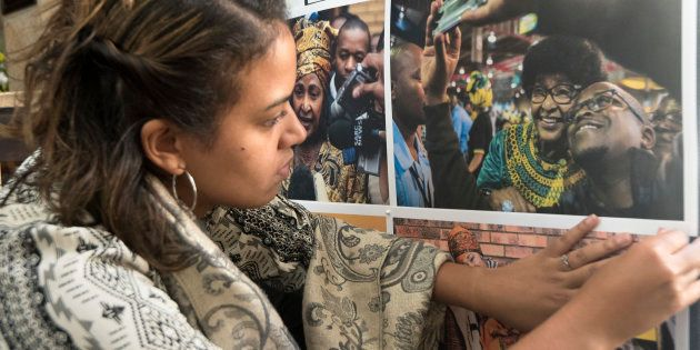 A woman prepares a picture memorial for the late South African anti-apartheid campaigner Winnie Madikizela-Mandela...