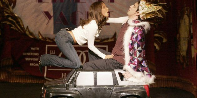 Actress Halle Berry (L) seduces Hasty Pudding Theatricals cast member Sam Gale-Rosen (R) as she performs...