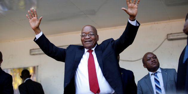 Jacob Zuma, former president of South Africa, waves to his supporters on his way to the high court in...