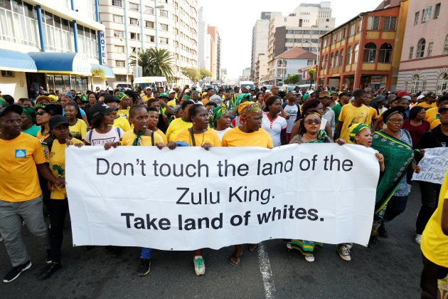 Supporters of Jacob Zuma march to the high court in Durban. April 6,
