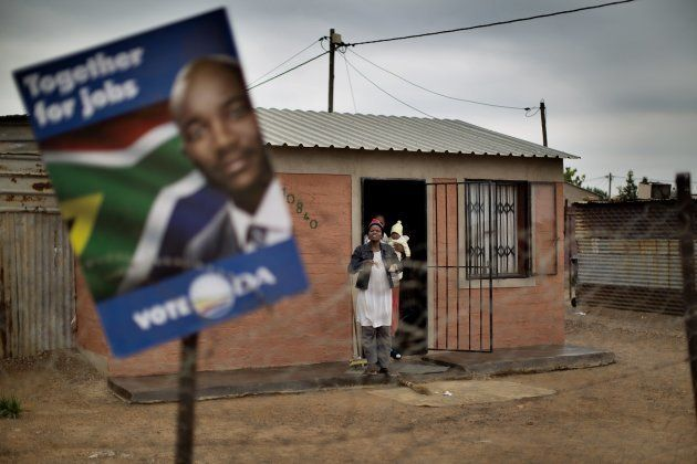 A DA election poster hangs askew in a township in Hammanskraal, north of Pretoria, ahead of the general...
