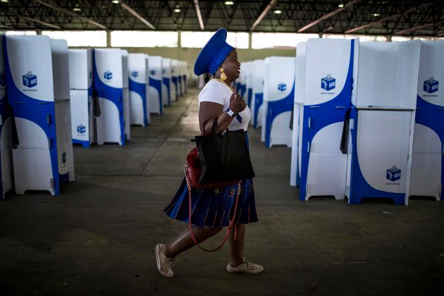 TOPSHOT - A Democratic Alliance (DA) member walks through the voting hall after casting her vote at the...