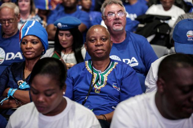 Johannesburg mayor and DA leader Herman Mashaba (C) sits in the crowd during policy resolutions at the...