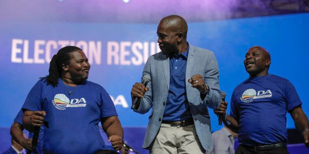 DA leader Mmusi Maimane dances with other party members during the closing of the federal congress in...