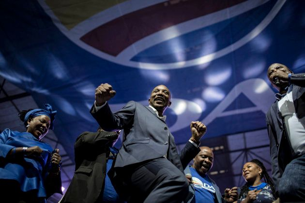 South African opposition party, the Democratic Alliance (DA) leader Mmusi Maimane (C), dances with other...