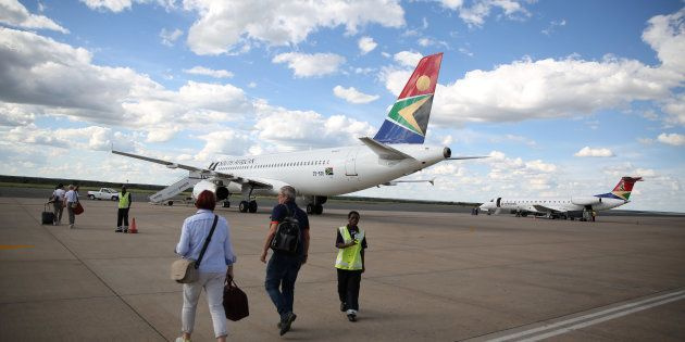 Passengers board an SAA aircraft at the Hosea Kutako International Airport outside Windhoek in