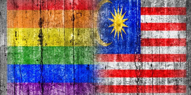 LGBT and Malaysia flag on concrete