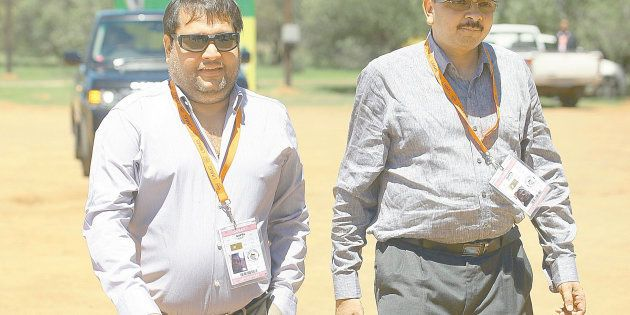 Brothers Ajay and Rajesh Gupta arrive as VIP guests at the ANC conference on December 17 2012 in Bloemfontein,...