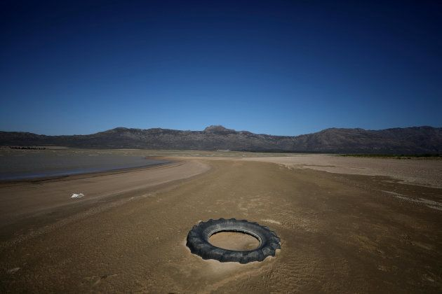Debris is seen as water levels fall to about 24 percent full at Voelvlei Dam, one of the region's largest...