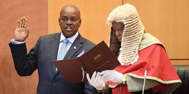 Botswana's new president, Mokgweetsi Masisi (L), takes the oath as the fifth president of Botswana in...