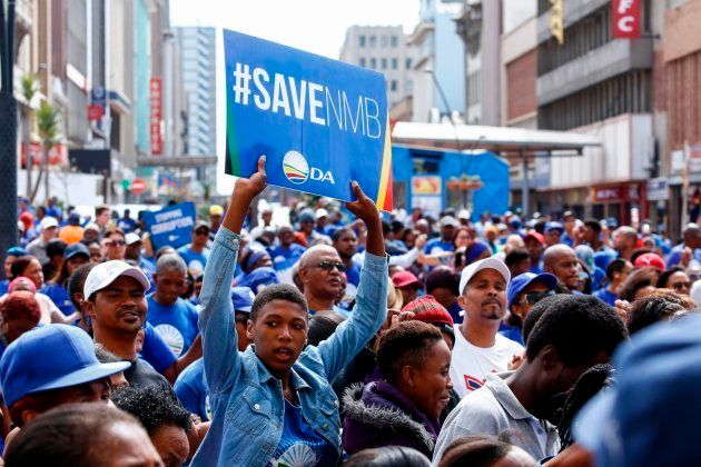 Supporters of DA Port Elizabeth mayor Athol Trollip demonstrate in front of the city hall at a rally...