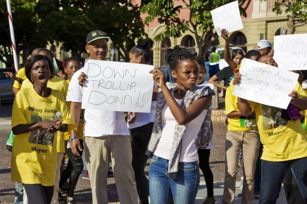ANC supporters demonstrate against DA mayoral candidate for Nelson Mandela Bay municipality, Athol Trollip...