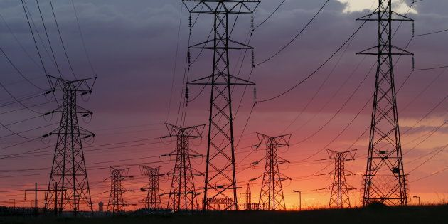 Electricity pylons are seen as the sun sets in Soweto, outside Johannesburg, April 17,