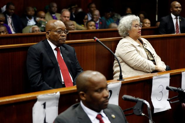 Former South African president Jacob Zuma (L) and accused number two the company Thales represented by...