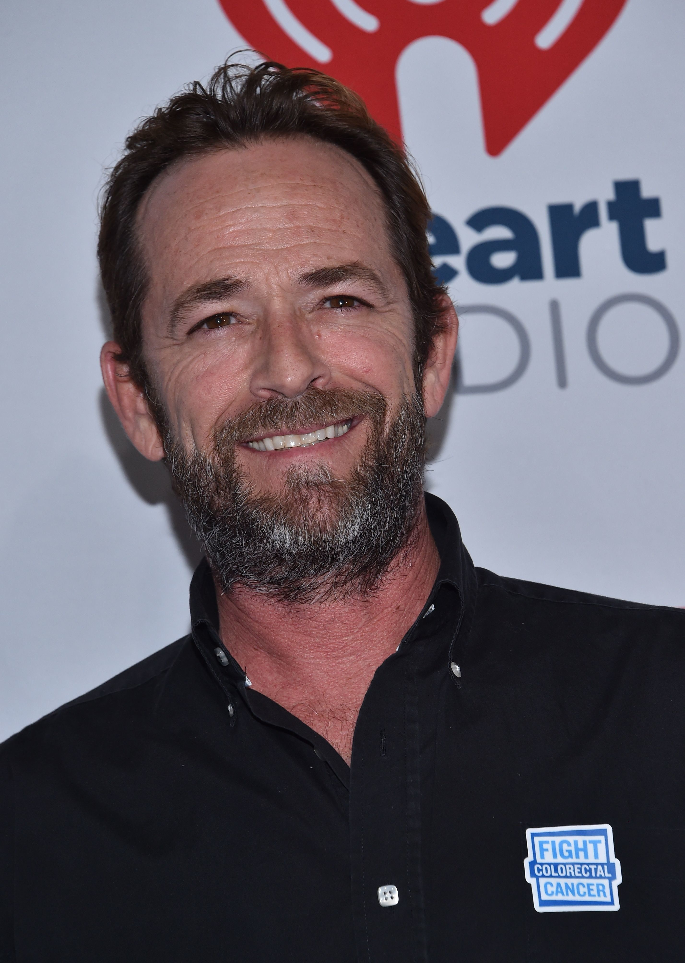 Actor Luke Perry arrivesin the press room for day 2 of iHeartRadio Music Festival in Las Vegas, Nevada on September 22, 2018. (Photo by CHRIS DELMAS / AFP)        (Photo credit should read CHRIS DELMAS/AFP/Getty Images)