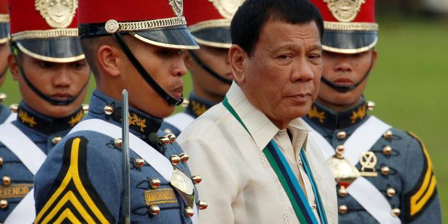 Philippine President Rodrigo Duterte walks with cadets of the Philippine Military Academy during the...