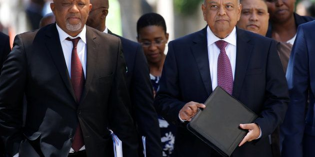 South African Finance Minister Pravin Gordhan and Deputy Finance Minister Mcebisi Jonas arrive for the...