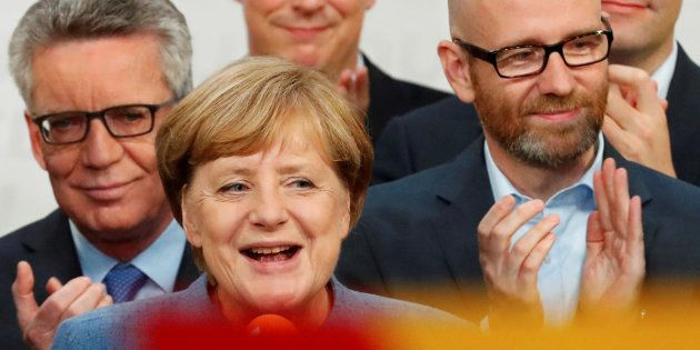 Christian Democratic Union CDU party leader and German Chancellor Angela Merkel reacts after winning...