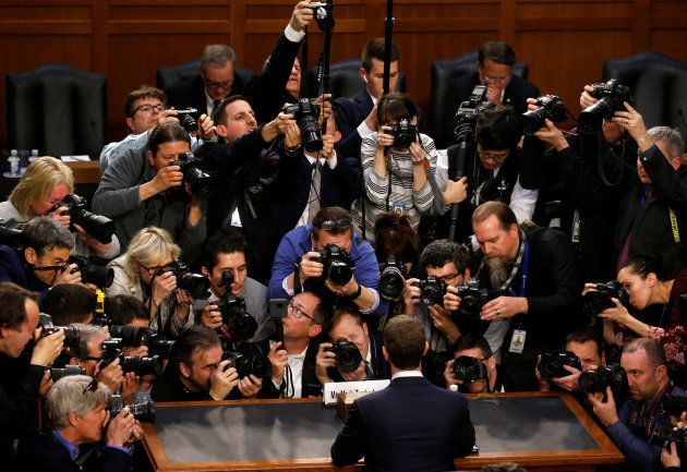 Facebook CEO Mark Zuckerberg is surrounded by members of the media as he arrives to testify before a...