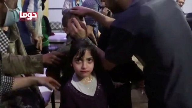 A girl looks on following alleged chemical weapons attack, in what is said to be Douma, Syria in this...