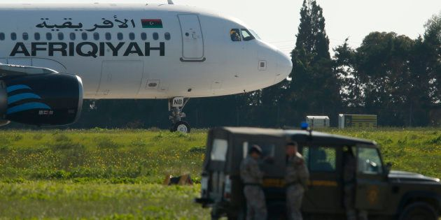 Maltese troops survey a hijacked Libyan Afriqiyah Airways Airbus A320 on the runway at Malta Airport,...