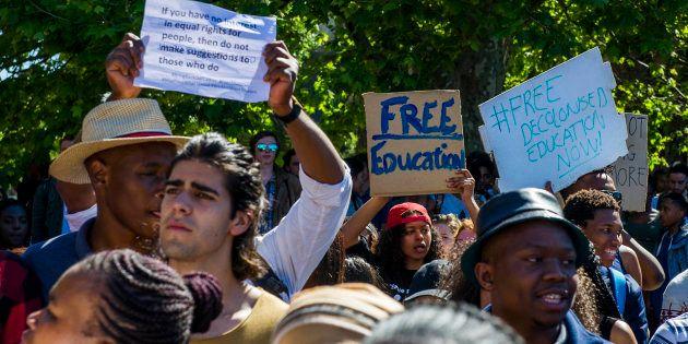 University of Cape Town students march during the #FeesMustFall protest on October 03, 2016 in Cape Town,...