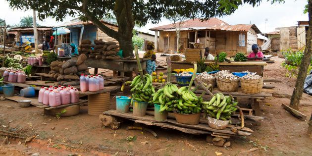 Local fruit market in the street, where people sell local fresh fruit in a village at Ondo state in Nigeria,...