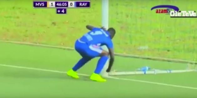 Mukura Victory striker Moussa Camara allegedly inserting some kind of talismanic object into the ground...