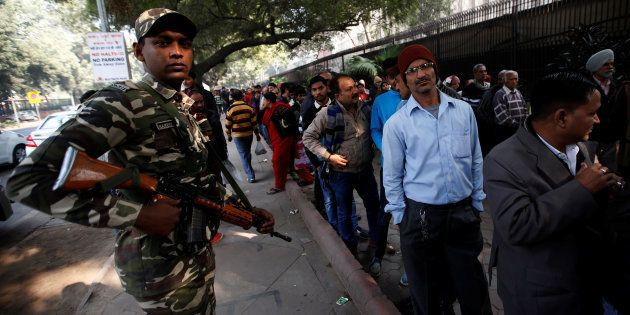 People queue outside the Reserve Bank of India to exchange their old high denomination bank notes as...