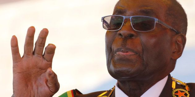 Zimbabwe's President Robert Mugabe gestures as he addresses a gathering in a speech to mark the National...