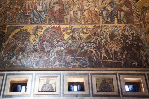 Florence, Italy. July 2013. View of the mosaic of the Baptistery of St John and the three-headed devil...