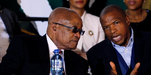 South Africa's President Jacob Zuma chats with Premier of North West Province Supra Mahumapelo before...